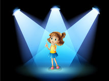 A girl standing in the spotlight Royalty Free Stock Photos