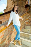 Girl standing on the stairs Royalty Free Stock Photo