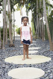 Girl Standing On Stepping Stone Stock Image