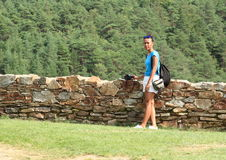 Girl standing by stone wall on Velhartice Castle Stock Image