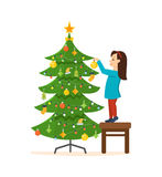 Girl standing on a stool, decorated with New Year Christmas. Little girl standing on a stool, decorated with New Year Christmas tree, various toys, garlands royalty free illustration
