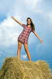 Girl standing on straw bail Royalty Free Stock Photo