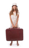 Girl standing with suitcase. Isolated on white Stock Images