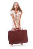 Girl standing with suitcase. Isolated on white Royalty Free Stock Image