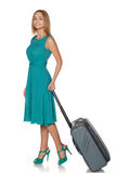 Girl standing with suitcase for travel and smiling Royalty Free Stock Image
