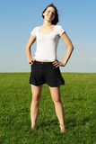 Girl standing on summer meadow and  smiling Stock Image