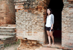 Girl standing in temple Stock Images