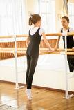 Girl standing on tiptoe at dance class near mirror Stock Photography