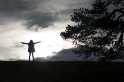 Girl standing on the top of the hill Royalty Free Stock Photos
