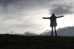 Girl standing on the top of the hill Stock Photography