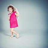 Girl standing with umbrella Stock Photos