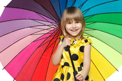 Girl standing under colorful umbrella Royalty Free Stock Photography