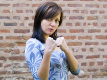 Girl standing up and preparing to fight Stock Images