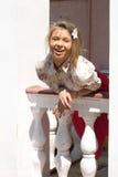 Girl standing on a veranda Stock Photos
