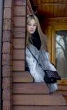Girl standing on a veranda Stock Image