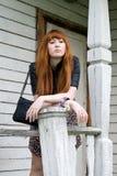 Girl standing on a veranda Royalty Free Stock Photos