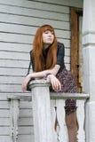 Girl standing on a veranda Royalty Free Stock Photo