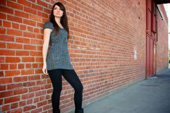 Girl standing by wall Royalty Free Stock Photography