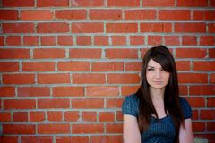 Girl standing by wall Stock Photography