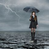 Girl standing on water. Girl with umbrella, standing on water Royalty Free Stock Image