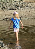 Girl standing in water Royalty Free Stock Photography