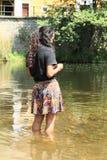 Girl standing in water Stock Photo