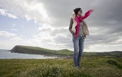 Girl standing in wind Royalty Free Stock Images