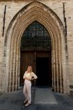 Girl standing wooden door Gothic Church royalty free stock photos