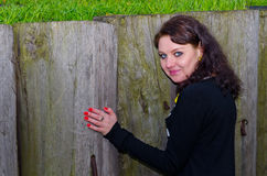 Girl standing at a wooden fence Stock Photos
