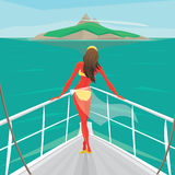 Girl standing on a yacht and admire the island Stock Photos