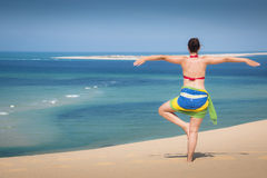Girl in a standing yoga pose in the beach. Of the Bazaruto Islands near Vilanculos in Mozambique with the Indian ocean in the background Royalty Free Stock Photos
