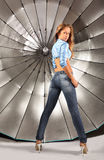 Girl stands back to camera near umbrella Stock Photo