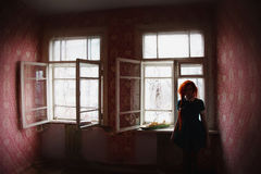 Girl stands on the background of window Stock Photos