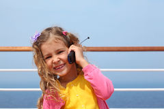 Girl stands on board ship, says by portable radio Stock Photos