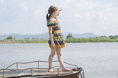 A girl stands on a boat Royalty Free Stock Photos
