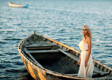 Girl stands in a boat and smiling Stock Photography