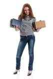 Girl stands with books Royalty Free Stock Photo