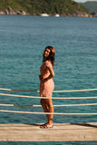 Girl stands on the bridge over the sea, Similan Islands, Thailand Royalty Free Stock Image