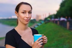 A girl stands with cup of tea Royalty Free Stock Photos