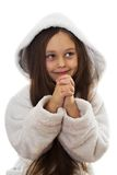 Girl stands with folded hands. Little smiling girl stands with folded hands Royalty Free Stock Photos
