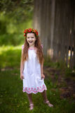 Girl stands on grass and laughing Royalty Free Stock Photos