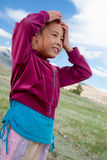 A girl stands in the Kazakh steppe royalty free stock photography