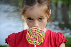 Girl with freckles enjoys lolly
