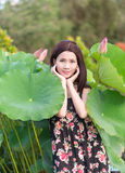A girl stands with the lotus leaf Royalty Free Stock Photos