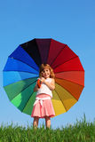 Girl stands in meadow and holding umbrella Royalty Free Stock Image