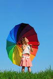Girl stands in meadow and holding umbrella Royalty Free Stock Images