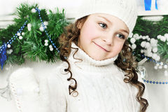 Girl stands near the Christmas tree stock photos