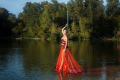 Girl stands near a pole dance. Stock Photo