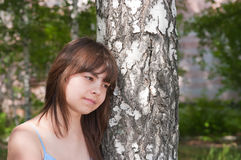 The girl stands near to a birch Royalty Free Stock Photo