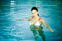 Girl stands in the pool Stock Photo